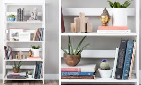 well-decorated white bookcases