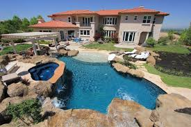 swimming pool backyard. Simple Backyard Rock Feature Backyard Swimming Pool And Hot Tub To