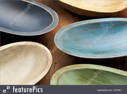 kitchen abstract composition of five rustic painted dough bowls against grunge wood surface