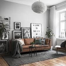 magnificent ideas tan living room rug brown sofa set with vintage painting and grey floor rug