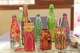 hand painted glass bottles and jars repurpose for artful vases for decor