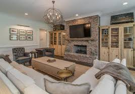 view full size beautiful living room features a red brick fireplace