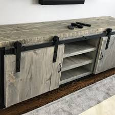 rustic industrial barn board a stand w sliding doors by jeremy paradis