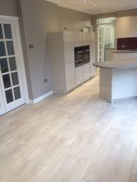 karndean opus flooring installed by us the large tiles work in this stunning kitchen