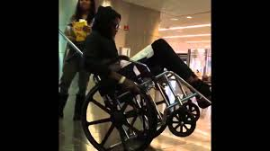 young thug rides around on wheelchair in airport till security stops him for doing wheelies you