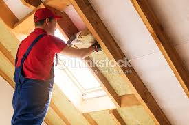 House Attic Insulation   Construction Worker Installing Rock Wool In  Mansard Wall : Stock Photo