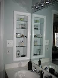 We could do this on the left side of the master bathroom sink counter space  when we remodel: DIY: Medicine Cabinet but add a door to it.