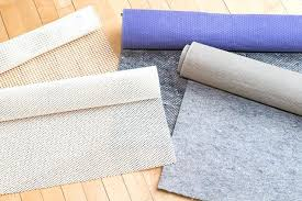 5x7 rug pads several rolls of rug pad material slightly unrolled atop a wooden floor area