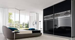 stylish interior furniture black closet ideas design feats glossy black glass sliding doors 936x502 capital closets