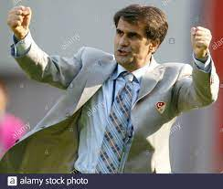 Turkey's coach Senol Gunes celebrates his team third goal against [China]  at the World Cup Finals in Seoul, June 13, 2002. Turkey won the match 3-0  and qualified for the second round