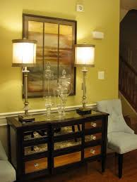 entryway furniture with mirror. gold glass and mirrors make a glittering first impression in this entryway flanked by two side chairs the striking table features on its drawer furniture with mirror t