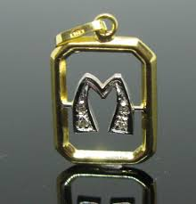 18 kt yellow and white solid gold pendant letter m set with 4 diamond round brillant cut tot 0 05 ct g vvs1