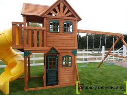 chic cedar summit playset made of wood in double tier house design with yellow slide and