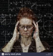 stock photo woman concentrating on solving mathematical equation