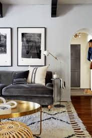 Emily Henderson designed living room | dark velvet grey sofa + round brass  coffee table +