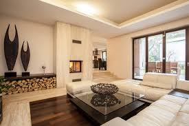 white living room with hardwood floor and wood fireplace