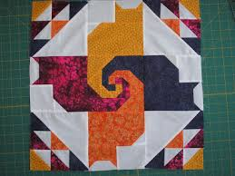 Cat block, tessellating tails - QUILTING & I couldn't find a pattern free or for sale for that one but did find a link  here for a free pattern for a full sized quilt: Adamdwight.com