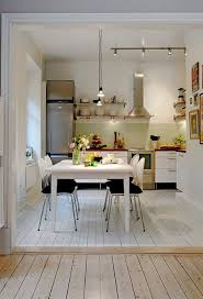 tremendous modern white kitchen design with white cabinet and eat in attractive kitchen bench lighting
