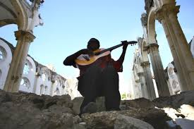 c easter holy week playing guitar in ruined cathedral in port au a photo essay a point of unity holy week and easter as seen by russian eyes acirc 02c easter holy week playing guitar in ruined cathedral in port au prince