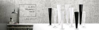 large selections of glass trumpet vases in diffe sizes and colors