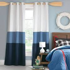 so after all my hunting for robot room stuff...i find these curtains.  Nautical ...