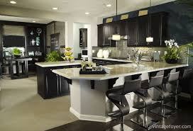 black and white contrasts are high end in modern kitchen designs and this room uses them to the max with light colored tile floorarble counter tops