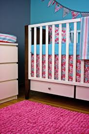 blossom bedding decorated baby cradles plus cushions combine with pink rug close with changing pad