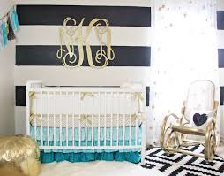 the boldness of the black and white stripe walls is softened with our aqua and gold dot crib bedding the grant turquoise ruffle skirt ties in perfectly