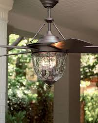 love the glass globe on this bronze outdoor ceiling fan horchow msrp 460 00