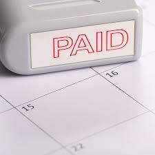 paid stamp on desk calendar