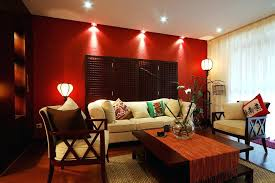 red living room living room with white furniture wood coffee table wood floor and one red