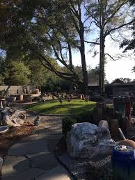 photo of stone garden wilmington nc united states lots of backyard statues
