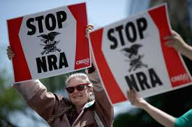anti gun control sign. Wonderful Gun Antigun Violence Demonstrators Hold Signs Condeming The National Rifle  Association During A Protest In In Anti Gun Control Sign O