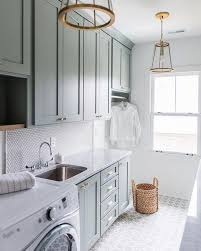a beautiful laundry room makes household cs so much more enjoyable does anyone else agree these light and bright laundry rooms would definitely having