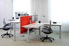 smart office interiors. Image May Contain: People Sitting, Table And Indoor Smart Office Interiors