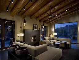 exposed lighting. living room with low profile lighting and exposed ceiling beams s