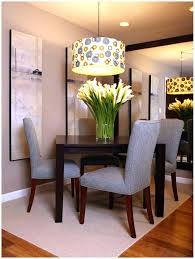 lighting for apartments. Apartments, Chandelier Black Table Chairs White Rug Carpet On Wooden Laminate Flooring Gray Wall Paint Lighting For Apartments