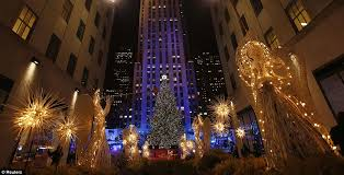 the tree is seen during the 80th annual rockefeller center tree lighting ceremony in new