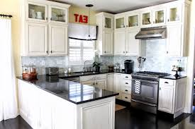 image of popular white kitchen cabinets with black granite