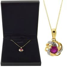 9ct 375 hallmarked yellow gold ruby and diamond swirl pendant 18 curb chain for