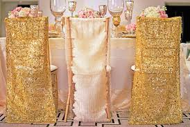 gold chair cover patterns wedding in padded chairs facing decorative flowers on round table