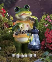 solar garden statue boy with flashlight and frog designs