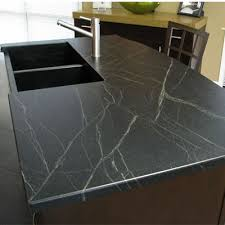 honed slate countertops bring the kitchen an understated look architectural stone works