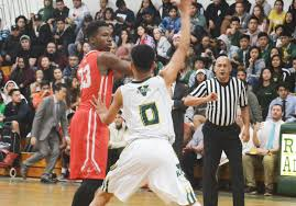 garden grove s brandon coleman 33 is defended by rancho s philip huynh in garden grove league play friday in the rancho gym the visiting argonauts won