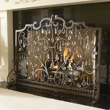 gorgeous fireplace screen from frontgate get magnets from hobby lobby and crystals and adorn your own fire place screen