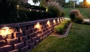 light landscape wall lighting stonework o silhouette dramatic entrance block retaining