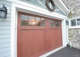 cottage garage doorsCottage Garage with Wood garage door  Glass panel door in