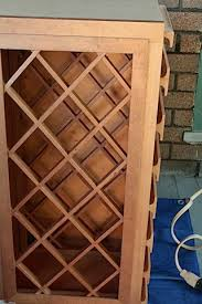 Dan had the brilliant idea of buying some scrap wood pieces and a cabinet  that was the same size as the wine rack, and putting them all together to  make a ...