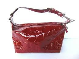 coach purse red patent leather embossed signature c pattern