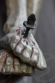 Closeup of feet of Jesus Christ nailed to the cross during the crucifixion.  Shallow depth of field. Defocused blurry background. by KYNA STUDIO. Photo  stock - Snapwire